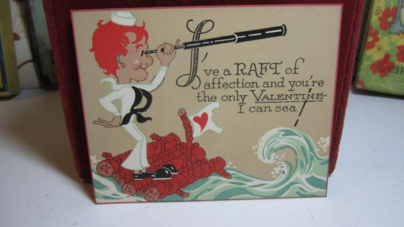 1920's-30's unused art deco hand colored nautical themed valentine sailor on raft looking through telescope