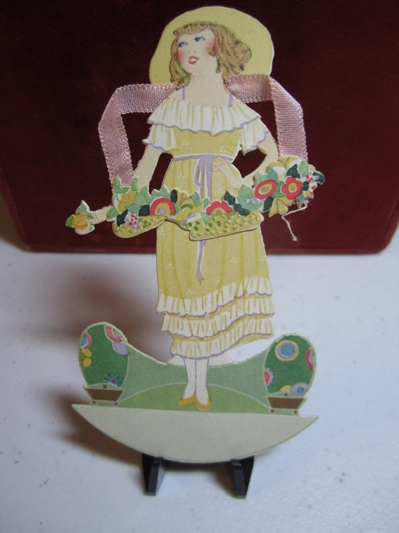 Gorgeous die cut art deco two piece place card beautiful woman in yellow dress hat  carrying flowers 1921 P.F. Volland