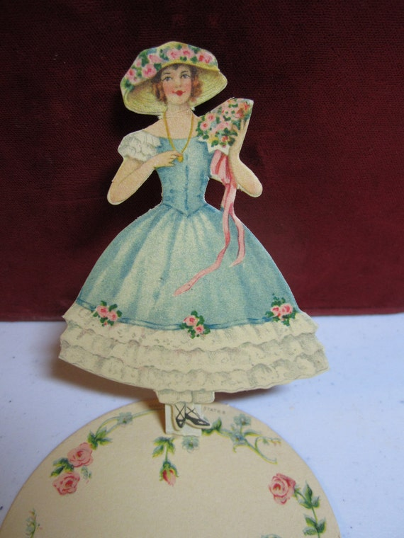 1920's die cut place card pretty lady in a crinoline dress with pantaloons and flower adorned hat