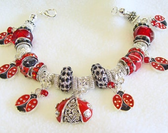 Handmade Lady Bug  Charm Bracelet with Crystal European Large Hole Beads #LadyBugCharms #redbracelet #ladybugjewelry #redandblack