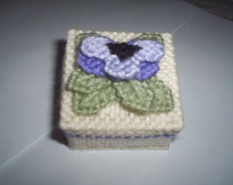 Needlepoint box with pansy.