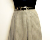 High Waisted Skirt in Black and White Pleated Dogtooth Fabric. Vintage, 1980s. Size S.