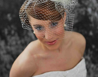 Bird Cage Veil- 9 inches long, white, with scattered Swarovski crystals-- with Orchid Fascinator