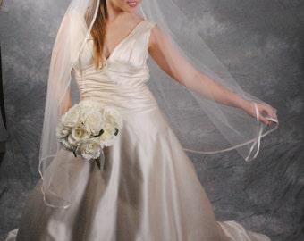 Ivory, fingertip length, satin ribbon edge veil