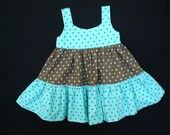 A lovely turquoise and brown polka dot pull over dress.