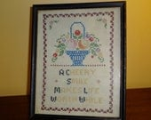 Framed Cross-stitched Sampler with Basket of Flowers, Dated April 5, 1953