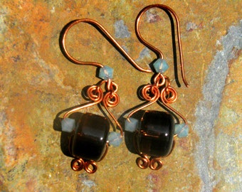 Copper wire wrapped 4 spiral brown resin & blue crystals earrings