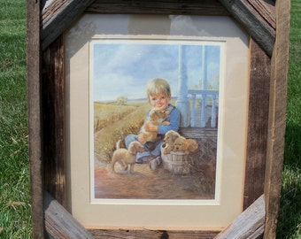 Boy with puppies matted picture in brown barnwood frame