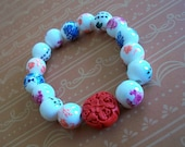 Ceramic Flower and Red Cinnabar Beaded Bracelet
