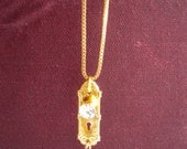 Tiny ornate rhinestone door knob and key necklace on a gold plated box chain