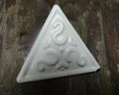 white triangular earrings