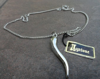 Vintage Lyntone  silver metal pendant and necklace TUSK