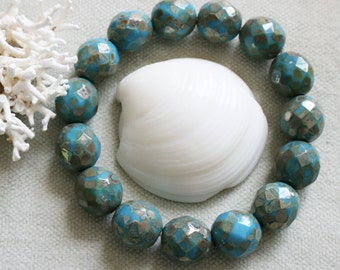 11mm . Czech Pressed Glass Faceted Rounds with flecks of mica like picasso .  Antique Blue . 6 beads