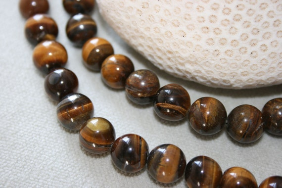 10mm . Tigers Eye round beads . 27 beads