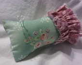 Floral ruffled pincushion in soft green with pale pink roses