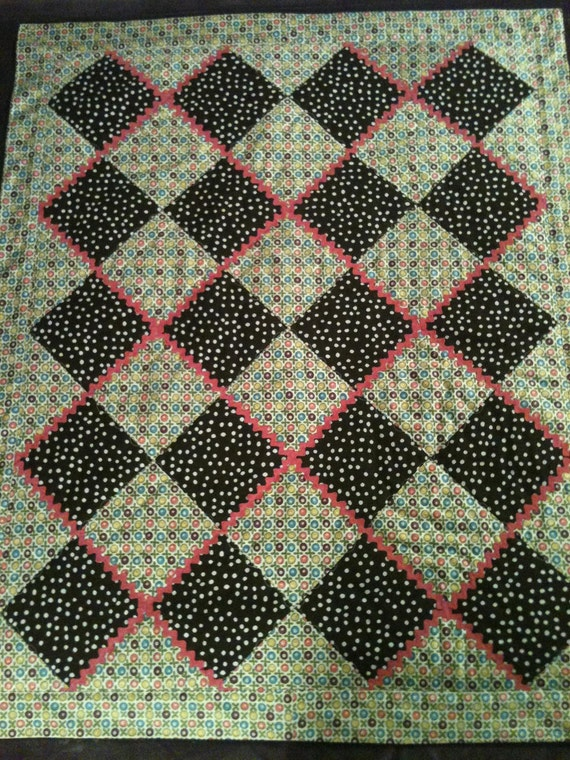 "Chocolate Brown, Rick Rack and Designer Florals Are Set To Please In This 29"" X 36"" Quilt For Baby Girls"
