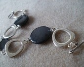 Oval and Round black mother of pearl bracelet with silver connector links and toggle clasp