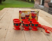 Egg cups in retro orange - set of four with four egg spoons: Emsa Bologna Series