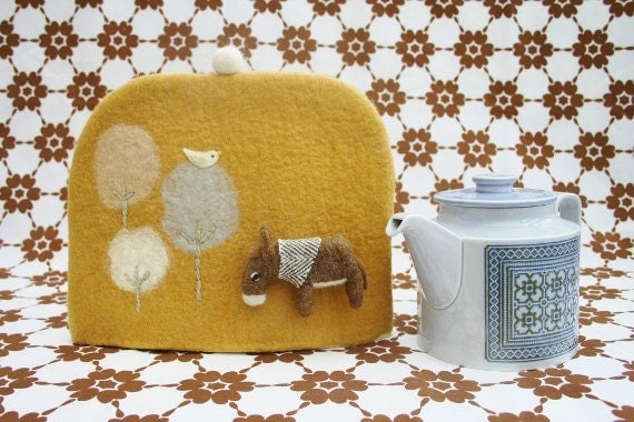 Hand felted tea cosy with donkey badge, bird and trees -Peach yellow