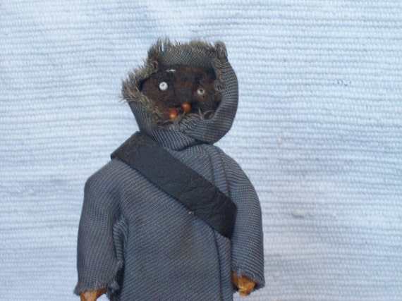 vintage made Apple headed doll that seems to be one of the Jawas from Star Wars..