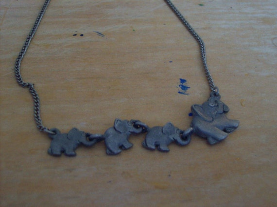 Line of Grey elephants Necklace. Vintage pewter.