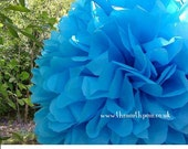 The North Pom Large paper pom pom in Turquoise
