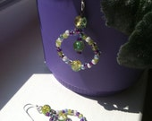 SOLD Colour de Caldo earrings in purple, green and other colors with silver accents.