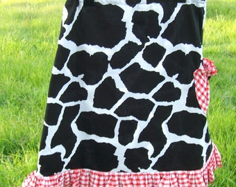 Girls skirt size 6, cowgirl  skirt, black and white cow spot skirt with red gingham ruffle and slouchy button pocket.