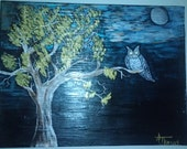 Midnight Owl- Perched on a tree branch in the light of the moon