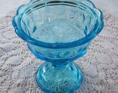Blue Glass Pedestal Style Candy Dish with Strawberry Design and Fluted Edges