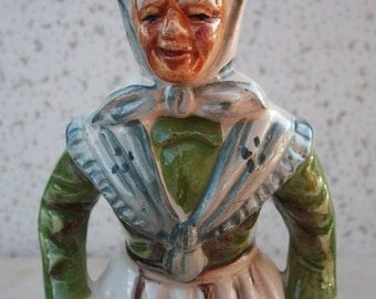 Old Woman with Dog Figurine