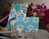 Mini Bag.. Perfect for  your Phone, iPod, MP3 players, traveling, hiking, back to school and much more. Teal and cream perfect for fall.