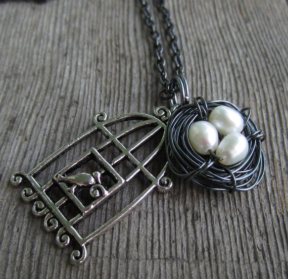 Bird cage and hematite wire nest with fresh water pearl 'eggs'