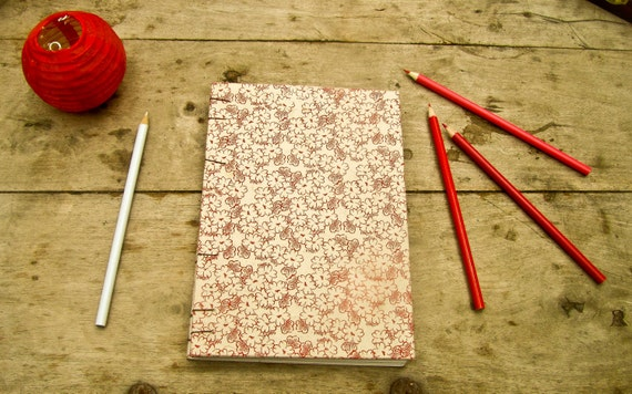"""ON SALE""""  Little Red Flower handmade hardcover journal/sketchbook with recycled blank white pages and Burgundy Coptic stitching."""