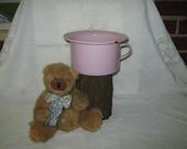 Pink enamelware child's chamber pot