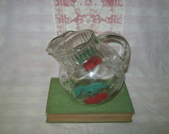Glass ball pitcher with tomatoes