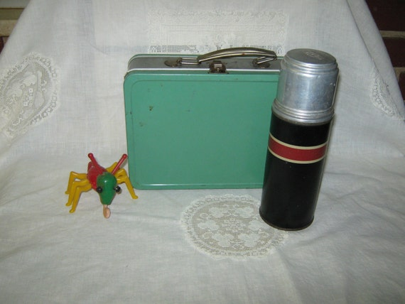Child's tin lunch box and thermos