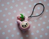Rilakkuma (Korilakkuma) in a Pink Bunny Hat with a Strawberry Charm