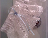Wedding garter.. white lace with white and blue satin ribbon