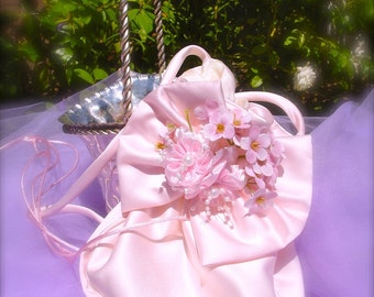 Pink pouch with little pink flowers