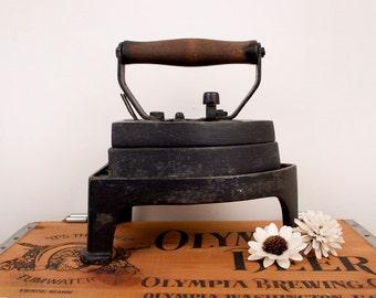 vintage Reimers iron with shoe stand door stop