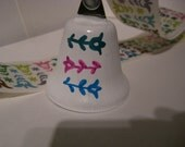 White Ribbon with Pink, Blue, Green Colored Flowers and Hand Painted Matching PittyPottyBell