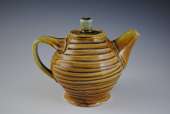 Amber Colored Ceramic Teapot  with Combed Slip Texture