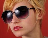 Vintage 1980's blue/teal metal framed sunglasses with purple fade lenses