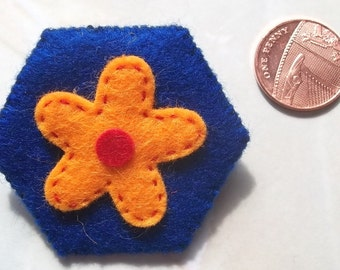 Hand stitched felt flower brooch in orange and blue