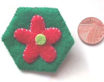 Hand stitched red felt flower brooch
