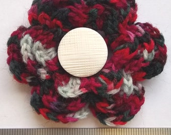 Irish crochet flower brooch in black, red and white