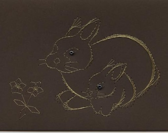 Greetings card with rabbit design
