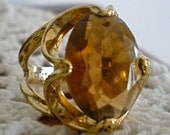 SALE PRICE 18kt gold filled cocktail ring with large amber/honey colored rhinestone