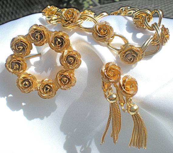 Gold tone rose demi parure bracelet, brooch and clip earrings sale price